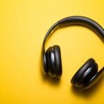 picture of headphones playing classic alternative music against yellow background